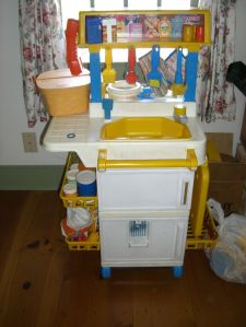 This was my play kitchen. By today's standards it's heinous. But man did I love it. It had a corded phone.